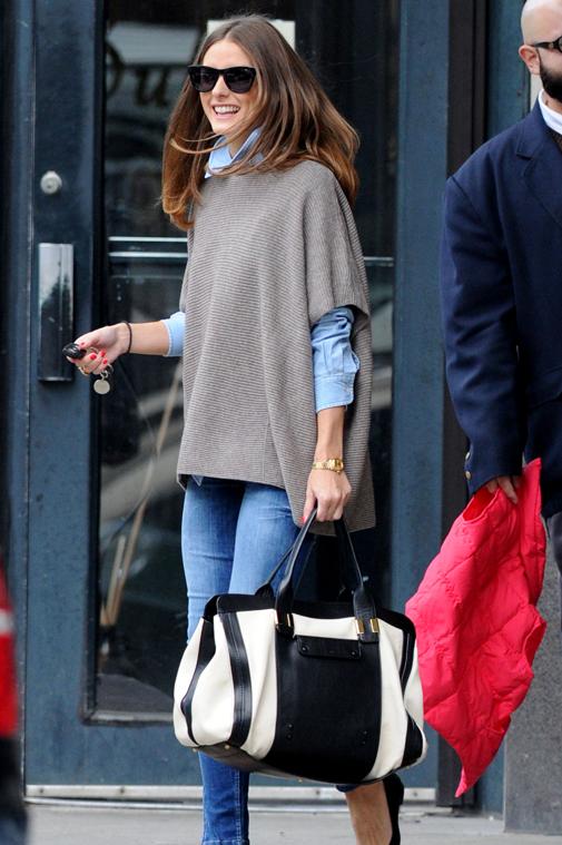 Olivia Palermo carries an oversized designer handbag in Brooklyn, New York City