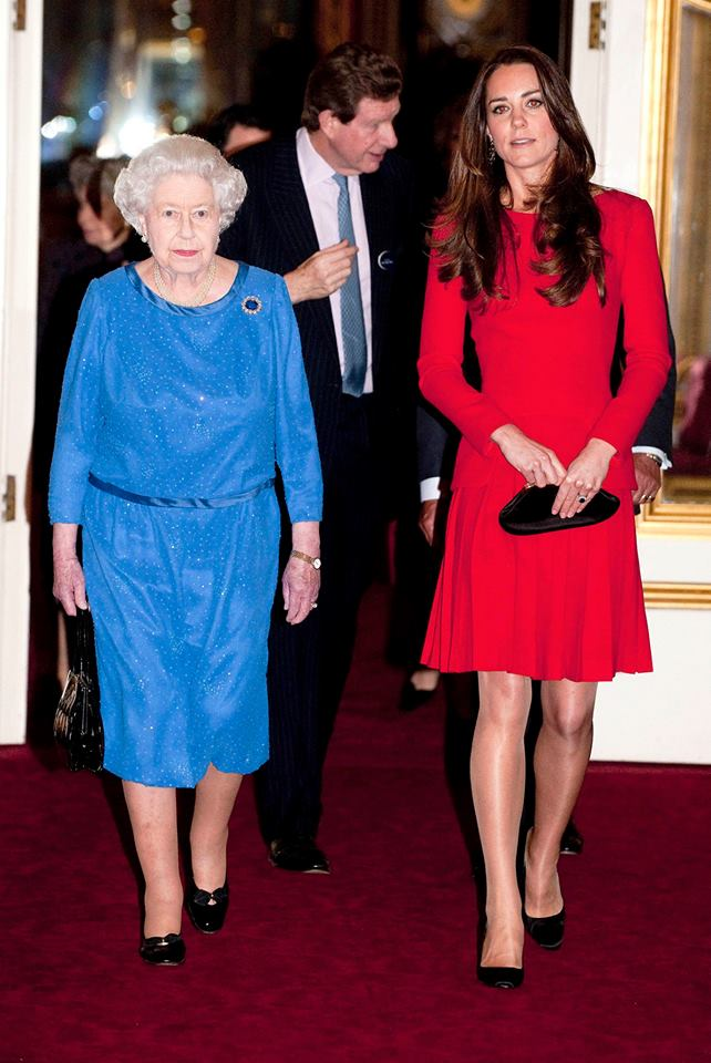 Kate Middleton in a red pleated AMQ